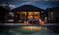 Pool by night at Acacia Farm Lodge