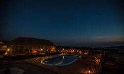 Pool by night Karatu Simba Lodge