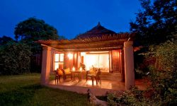 Africa; Botswana; Chobe National Park; Sanctuary Chobe Chilwero; Room exterior at night