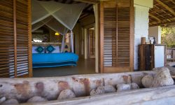 Matemwe-Retreat-bedroom-overlooking-beach