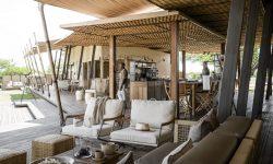 Singita-Sabora-Main-Lodge-Lounge-Bar-with-Staff-scaled